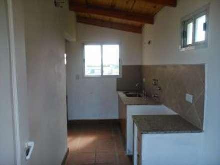 rustikale Küche von Arq. Gustavo Piazza & Asociados