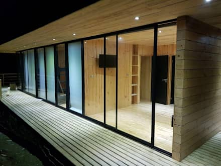 Fachada Principal : Cabañas de estilo  por Nido Arquitectos