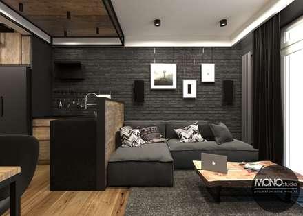 Salon w klimacie industrialnym: styl , w kategorii Salon zaprojektowany przez MONOstudio
