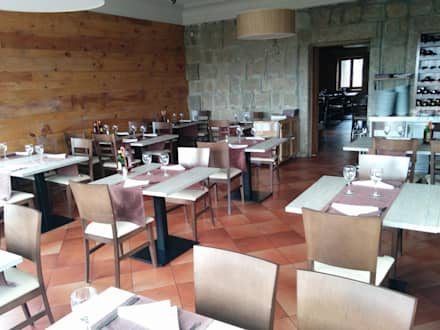 Salon del restaurante: Locales gastronómicos de estilo  de Reformas El Mago