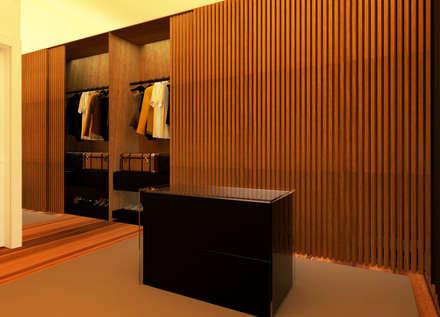 Apartamento no Lumiar: Closets modernos por Rita Glória interior design