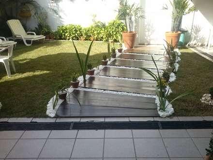 caminho entrada: Jardins modernos por STUDIO ROCHA ARQUITETURA E DESIGN DE INTERIORES