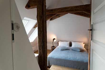 Dachgeschoss: rustikale Schlafzimmer von raumdeuter GbR