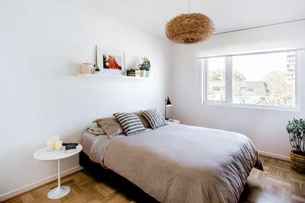 NS: Dormitorios de estilo moderno por Iragüen Viñuela Arquitectos