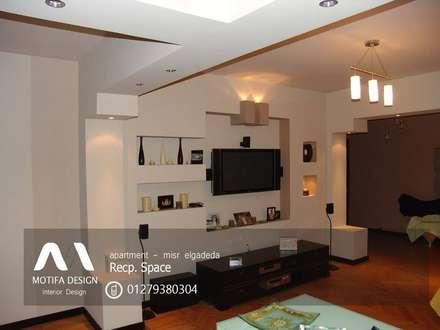 ID- apartment - misr elgadeda:  غرفة المعيشة تنفيذ Motif Design