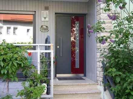 Neue Haustür in bestehendes Gebäude:  Tür von Treppenbau Biehler