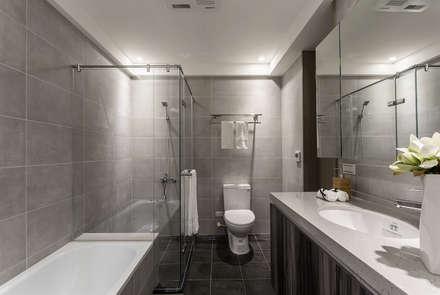 日光為題 漏水公寓的幸福新貌:  浴室 by E&C創意設計有限公司