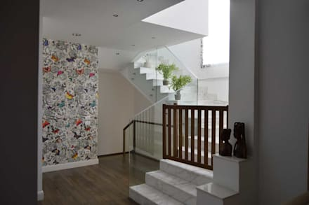 Duplex SE:  Corridor & hallway by El agizy Architecture and Design