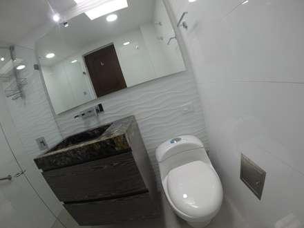 Mueble de baño 1: Baños de estilo moderno por MODE ARQUITECTOS SAS