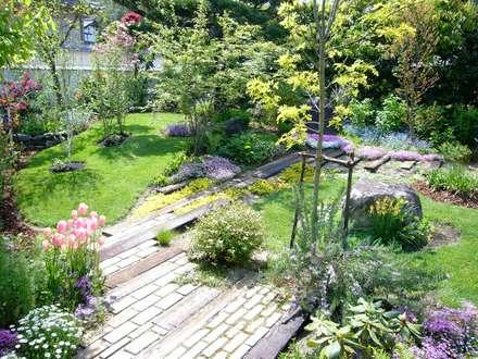 「生きる景色。」: GAZON~ガゾン~が手掛けた庭です。
