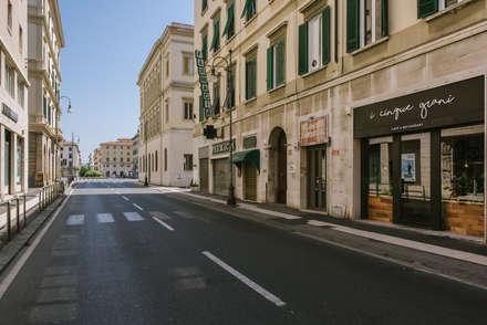 I Cinque Grani - Vetrina Dettaglio: Negozi & Locali commerciali in stile  di MODO Architettura