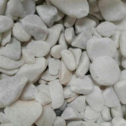 Piedras de marmol: Jardines de estilo minimalista por Grupo Cretto, C.A