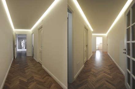 Architettura d'Interni in Stile Classico Contemporaneo: Ingresso & Corridoio in stile  di JFD - Juri Favilli Design