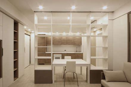 Arredamento di Design per un Monolocale a Milano: Sala da pranzo in stile in stile Scandinavo di JFD - Juri Favilli Design