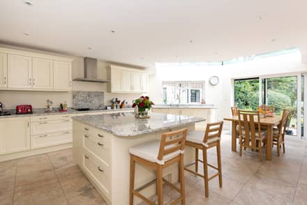 Bespoke roofing glazing and an extra floor extension: classic Kitchen by Corebuild Ltd