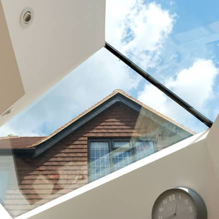 Bespoke roofing glazing and an extra floor extension:  Roof by Corebuild Ltd