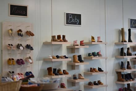 Tienda Marilá: Espacios comerciales de estilo  por Rinnovo