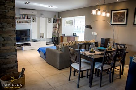 Casa 205: Livings de estilo ecléctico por Papillon Arquitectura