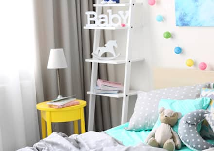 Beautiful curtains, blinds and soft furnishings:  Baby room by Bluebird Bespoke
