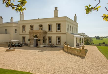 Lympstone Manor: colonial Houses by Intelligent Abodes Limited
