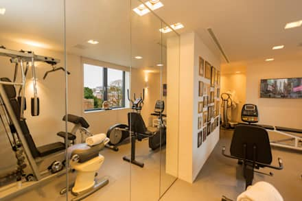 Exeter Penthouse: modern Gym by Intelligent Abodes Limited