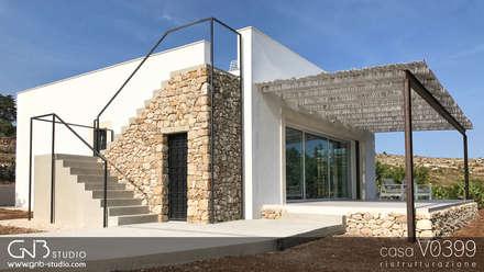 casa V0399: Casa unifamiliare in stile  di G'n'B studio