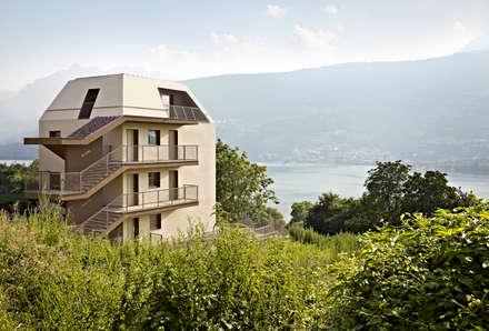 edificio plurifamiliare GI: Condominio in stile  di Burnazzi  Feltrin  Architects