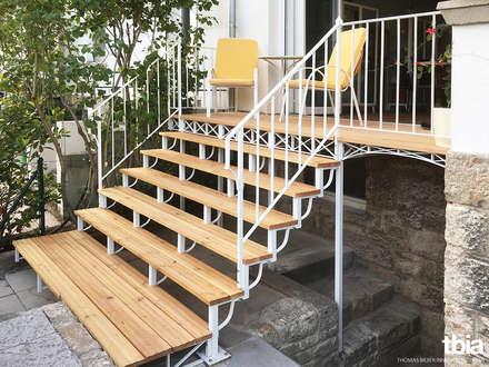 Austritt in den Garten: klassischer Garten von tbia - Thomas Bieber InnenArchitekten