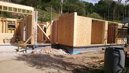 Timber Frame:  Prefabricated home by Building With Frames