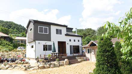 전북 진안 능금리 목조주택: 한다움건설의  목조 주택
