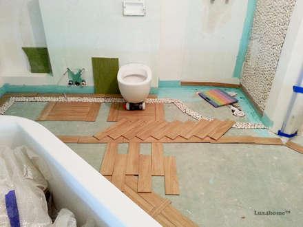 White Pebble Tiles Bathroom Ideas - Pebble Tile Bathtub: colonial Bathroom by Lux4home™ Indonesia