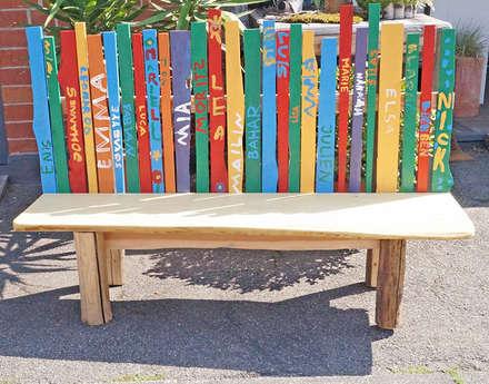 Holzbank für Außenbereich - von den Kindern bemalt:  Schulen von Schreinerei & Innenausbau Fuchslocher
