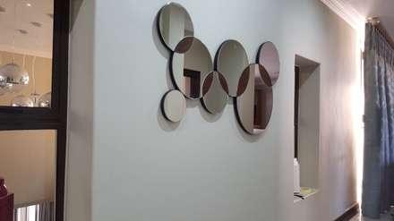 :  Corridor & hallway by SOJE Interior, Design and Decor PTY (Ltd)