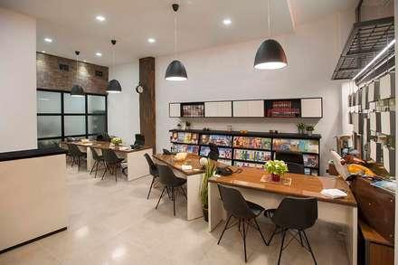 IRIS VIAGGI - Retail commerciale: Negozi & Locali commerciali in stile  di Studio Bellonio