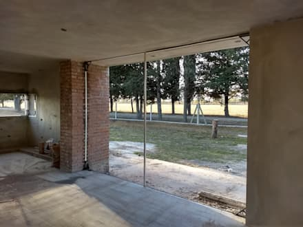 Casa en Serralta : Paredes de estilo  por 1.61 Arquitectos