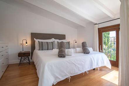 Dormitorio doble : Dormitorios de estilo industrial de Bornelo Interior Design