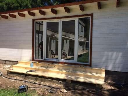 Casas de madera de estilo  de homify