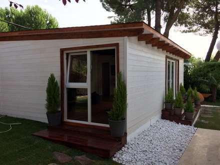 Casetas de madera habitable : Casas de madera de estilo  de Grupo Dancu 2017 S.L