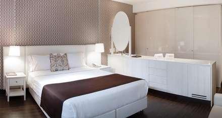 habitación tipica: Hoteles de estilo  por Ecologik