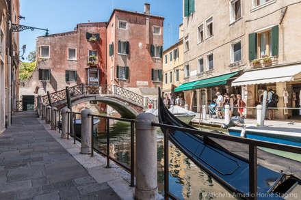 Venezia Dorsoduro - SHORT LET - Trasformazione affitto turistico/affitti brevi: Condominio in stile  di MICHELA AMADIO - Valorizza e Vendi