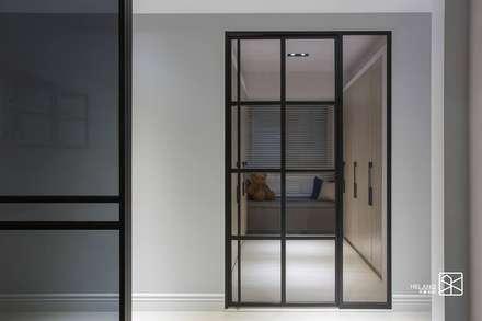 鐵件開門:  更衣室 by 禾廊室內設計