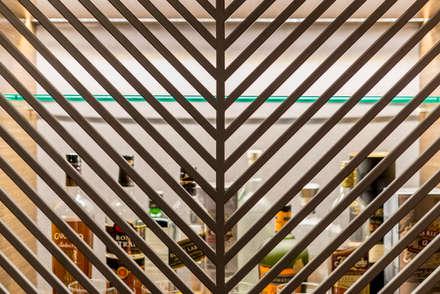 Loft del Piloto: Salas / recibidores de estilo ecléctico por Gracia Nano Studio