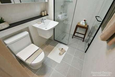 부산 호텔을 컨셉으로한 24평 아파트(2): 노마드디자인 / Nomad design의  화장실