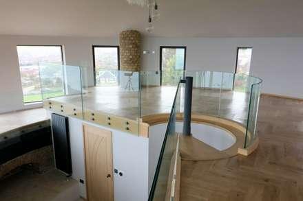 glass balustrade to mezzanine floor : modern Media room by Ion Glass