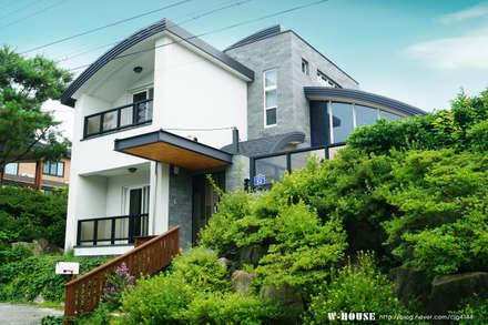 세종시 청벽마을 45평형 ALC친환경 리모델링: W-HOUSE의  전원 주택