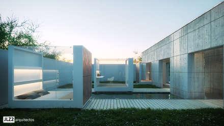 vista del patio interior: Casas ecológicas de estilo  de JLZ2 arquitectos