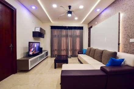 family living: modern Living room by Team Kraft