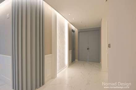 66평 강서구 엘크루블루오션 - 부산: 노마드디자인 / Nomad design의  벽