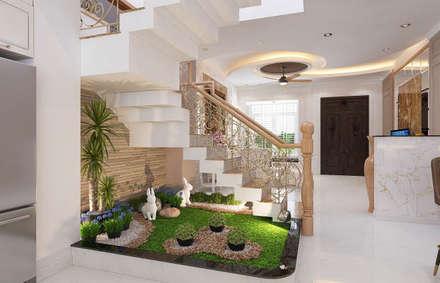 Tiểu cảnh nhỏ giúp không gian gần gũi với thiên nhiên hơn.:  Cầu thang by Công ty TNHH Xây Dựng TM – DV Song Phát