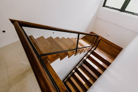 RT House:  Stairs by Living Innovations Design Unlimited, Inc.